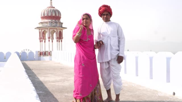 Beautiful-bride-and-groom-dating-leisurely-on-a-rooftop-in-Pushkar-Rajasthan-India