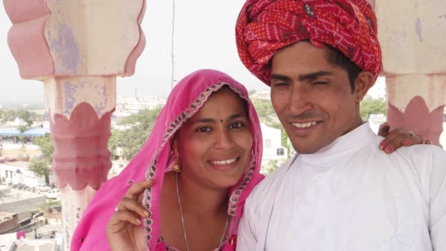 POV-of-selfie-stick-camera-taking-photo-and-video-of-Indian-bride-and-groom-in-India