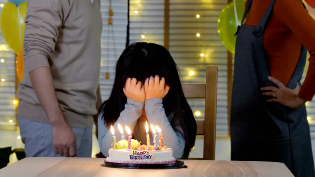 Little-girl-with-stress-situation-about-father-and-mother-arguing-in-her-birthday-