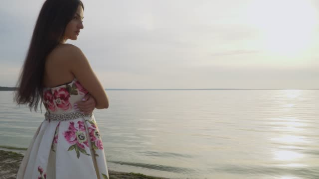 Romantic-girl-in-a-long-dress-by-the-river
