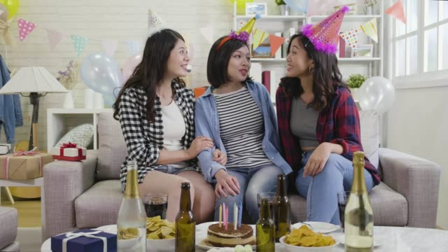 women-friendship-celebrate-with-gifts-and-alcohol