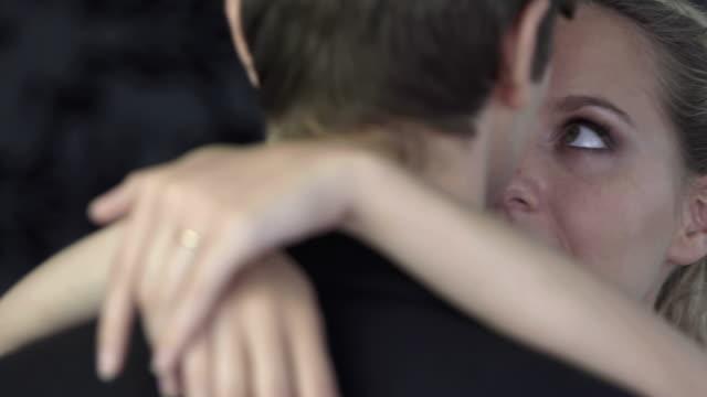 Newlywed-couple-hugging-and-dancing