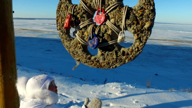 Girl-child-learns-wedding-amulet-The-child-is-very-interesting-what-it-is-Winter-walk-in-the-park-Frosty-winter-day-