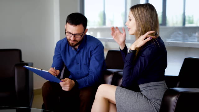 Reception-of-office-building-The-main-manager-tells-the-client-his-suggestions-A-woman-listens-attentively