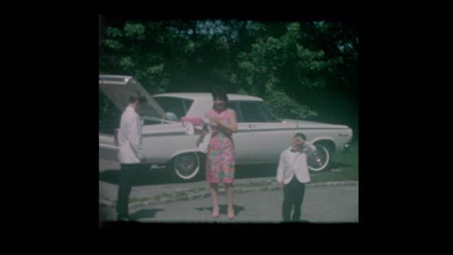 1960-s-Dressed-Formal-family-arrives-for-wedding