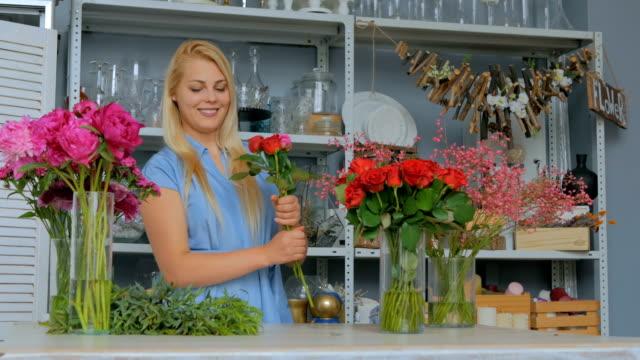 Professional-florist-making-floral-wedding-composition-at-flower-shop