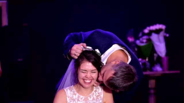 wedding-traditions-the-groom-removes-the-veil-from-the-bride-at-the-end-of-the-wedding-the-newlyweds-are-funny-laughing-and-happy