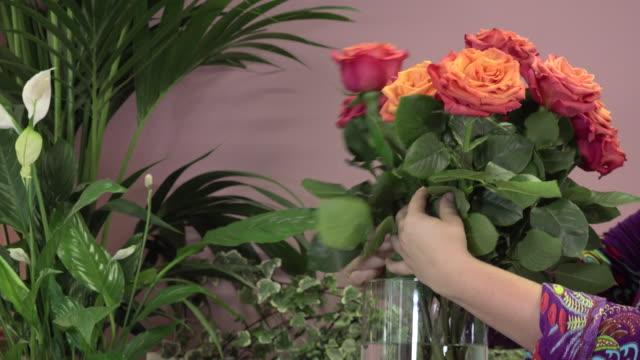 a-florist-manufactures-a-bouquet-of-roses