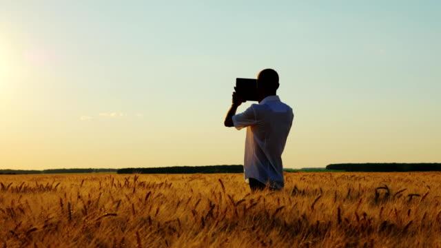 Farmer-Working-With-Digital-Tablet