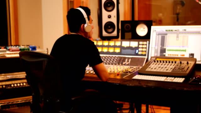Male-audio-engineers-using-sound-mixer