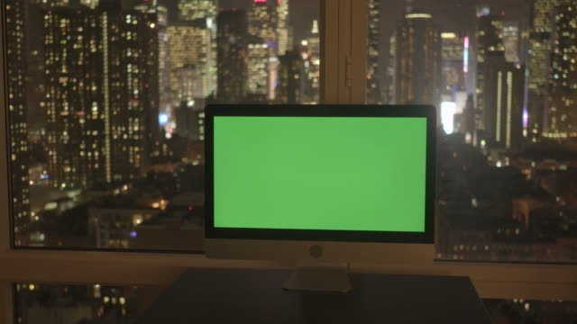 Computer-with-Greenscreen-in-Modern-Office-Building-with-Cityscape-Background-
