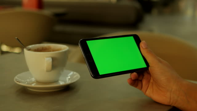 Tablet-with-Greenscreen-Chroma-Key-Used-in-a-Restaurant-