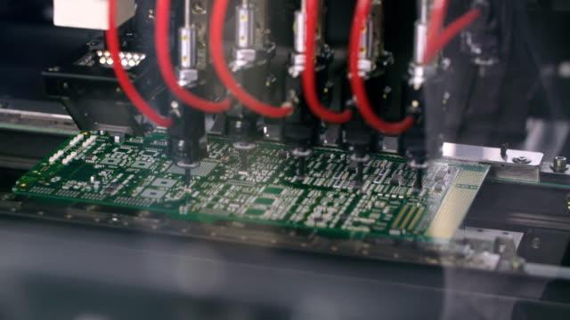 Máquina-superficial-de-Mount-Technology-(Smt)-coloca-elementos-en-tableros-de-circuitos