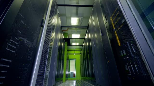 Fluorescent-tube-lamps-illuminate-a-data-storage-aisle-