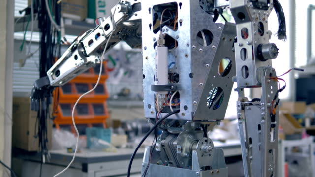 A-tall-humanoid-robot-uncovered-for-repairs-