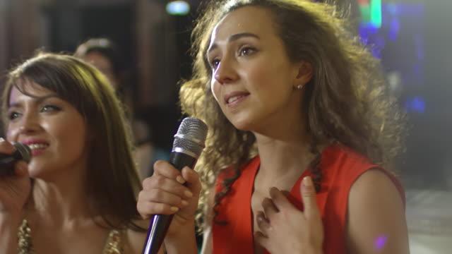 Two-Women-Singing-in-Karaoke-Bar