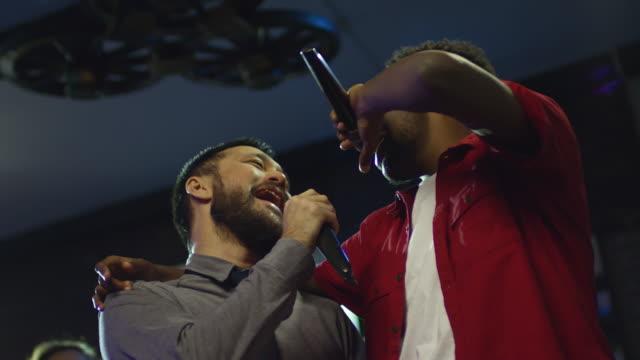 Drunk-Male-Friends-Singing-Karaoke