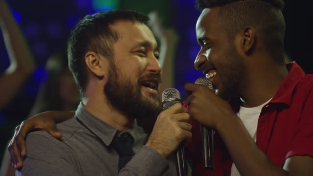Diverse-Male-Friends-Hugging-and-Singing