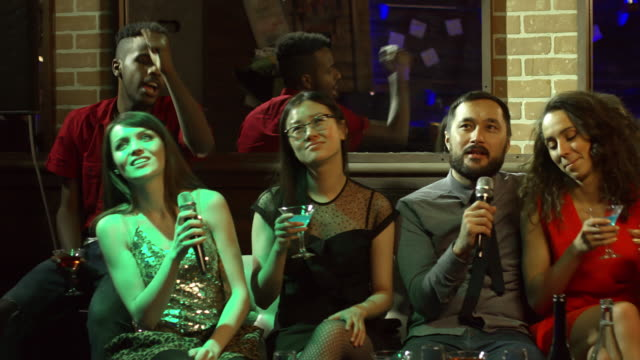 Five-Diverse-Friends-Singing-at-Party