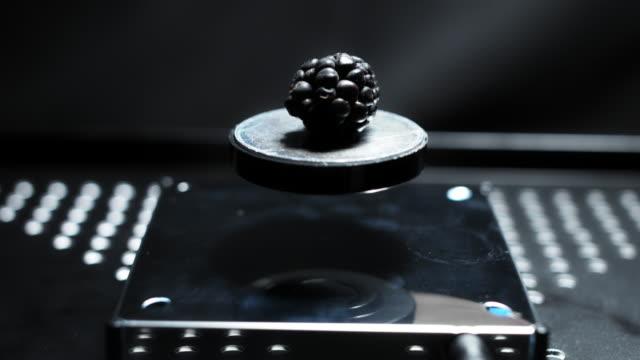 4K-Abstract-Levitation-Platform-with-Blackberry-on-Black-Background