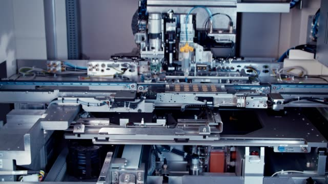 Automated-SMT-machine-placing-electronic-components-on-a-board