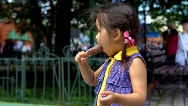 Little-girl-is-eating-ice-cream-