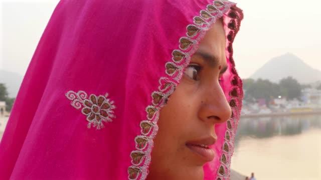 Husband-and-wife-talking-against-the-beautiful-sunset-at-Pushkar-Lake-India-handheld