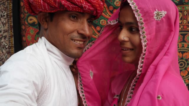 Handheld-POV-of-a-camera-taking-selfie-photos-of-a-beautiful-Indian-couple-in-traditional-clothing-in-Rajasthan-India