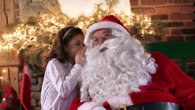 Girl-whispering-the-hidden-dreams-for-Santa-Claus
