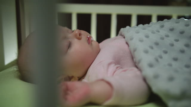 Side-View-of-Sleeping-Newborn-Baby-Dolly-Shot-Close-Up