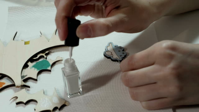 An-artist-paints-on-wooden-craft