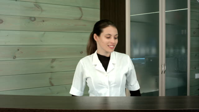 Smiling-beauty-salon-manager-at-the-reception-desk