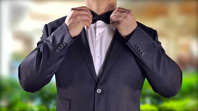 Groom-Elegant-Man-Tuxedo-Black-Bow-Tie-Destination-Wedding-Happy-Lifestyle