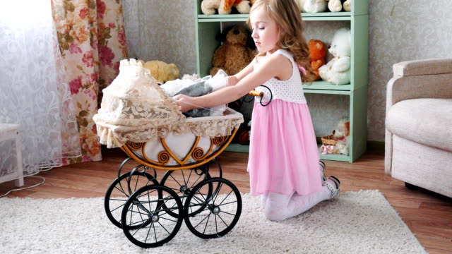 girl-dolls-placed-in-a-stroller-on-the-background-of-shelves-with-toys