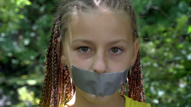 A-girl-with-a-taped-mouth