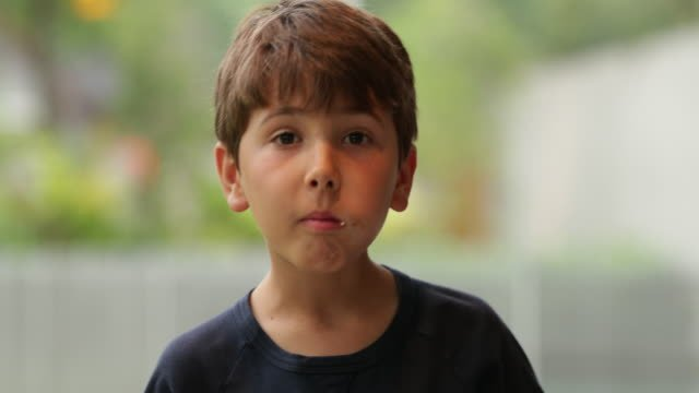 Expressive-child-becoming-angry-as-he-hears-news-Young-boy-with-an-expressive-look-on-his-face-acts-surprised-in-4k