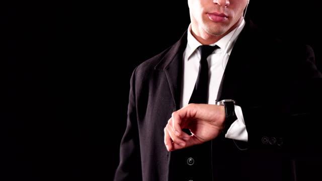The-young-James-Bond-checks-his-wristwatch