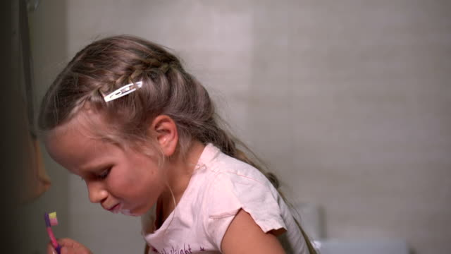 five-year-old-girl-brushes-teeth