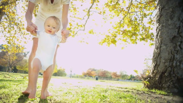 Portrait-of-baby-girl-practicing-her-first-steps