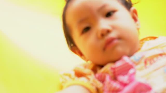 Asian-baby-girl-playing-slider-at-playground-