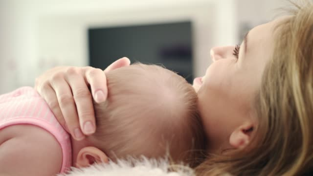 Mother-hugging-baby-Lovely-child-sleep-in-mother-embarce