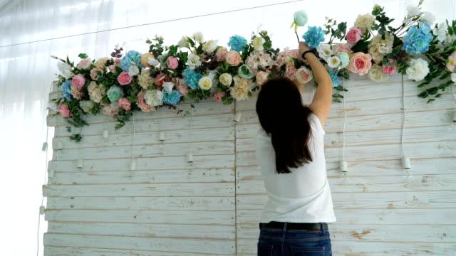 Beautiful-florist-creating-spring-colorful-bouquet-arrangement