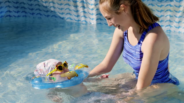 A-woman-with-a-baby-swims-in-the-pool