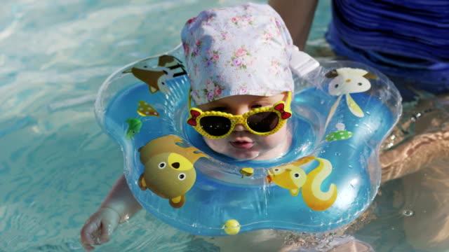 Baby-swimming-with-neck-swim-ring