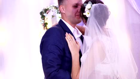 beautiful-happy-loving-couple-of-newlyweds-in-wedding-dresses-kissing-at-the-wedding-hugging-Kiss-the-bride-and-groom