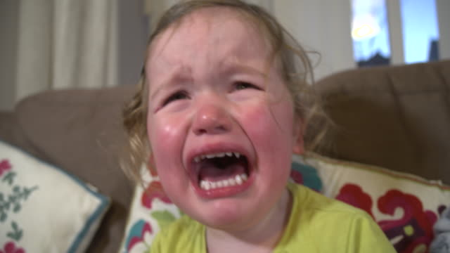 Toddler-girl-crying-with-mouth-wide-open-and-tears-down-her-face