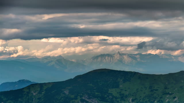 Dramatic-evening-thunder-clouds-sky-over-mountains-time-lapse