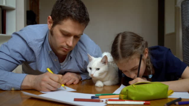 Family-with-cat-drawing-on-the-floor-