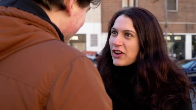 Angry-woman-arguing-with-her-boyfriend-in-the-street-betrayal-anger-break-up