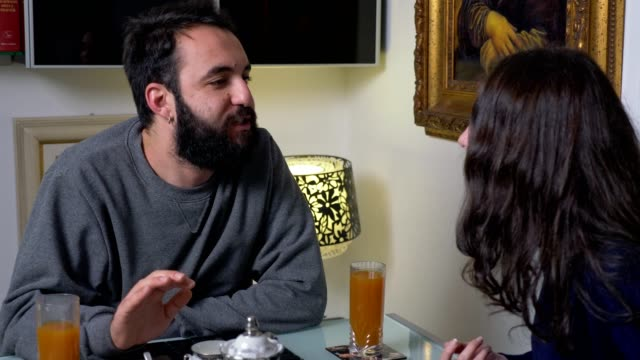 Crisis-marriage-arguing---young-couple-quarreling-during-breakfast